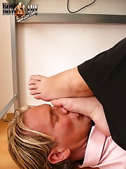 Mistresses foot on slaves facet