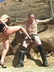 Female-dominator kicked her slave's genitals open-air