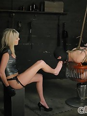 Two latex mistresses humiliated slaveboy