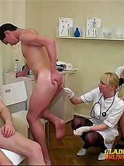 Crazy doctors stick fingers into ass-holes of naked schoolboys