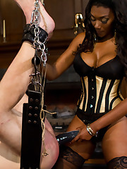 Pretty ebony pinches slave's dick and fucks him with dildo