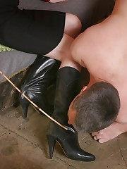 Mistress tramples a malesub by boots