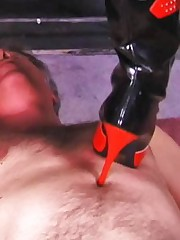 Dominatrix Candy Cotton ties her victim to cross and smothers