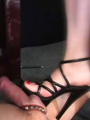 A dominatrix's high heels get into mischief on a captive