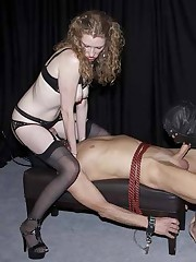 Young, blonde mistress has two male captives and makes one service the other