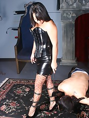 Michelle rushes her slave to her feet wearing fishnet thigh highs and strappy hardcore stilettos.