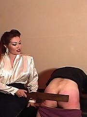 Classy older mistress disciplines younger man