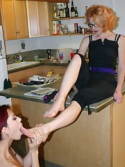 Redhead slavegirl is licking toes