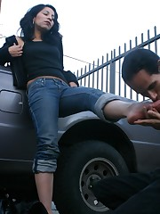 Outdoor foot worship near a car