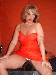 Mistress in red sat on slave