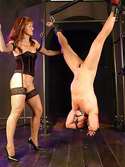 Mistress suspends gagged man upside down to fuck his slave ass with a glassy sextoy