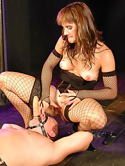Fetish mistress rides a dildo strapped to her slave`s face and smothers him with her cunt