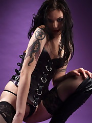 Faith in high leather boots and a laces corset.