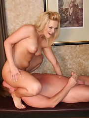 Blonde tattoo chick sat on slave