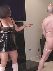 Two milf was beating bounded slave with whip.