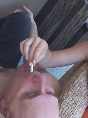 Two sluts was throwing ash in the slave's mouth.