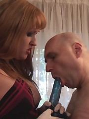 Slave's ass-hole gets penetrated with a long dildo