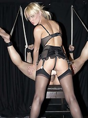 Blonde domina fucked slave by dildo and punished him by a paddle