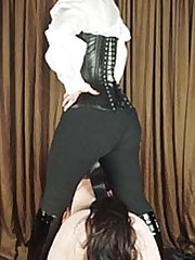 Dominatrixes sat on malesubs