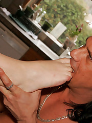 Brunette rubs stiff cock under nylon