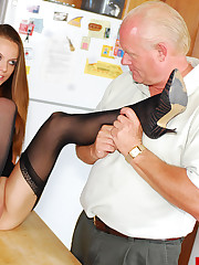 Old dude worships young babe's feet in stockings