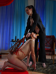 Naked guy put to an endurance test by a bossy mistress with perverted mind