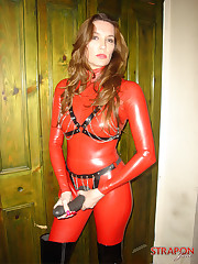Mistress in red latex with strapon