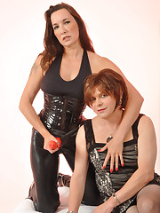 A mistress gets her strapon sucked by sissy man