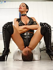 Crazy leather Mistress sitting on her sub's face