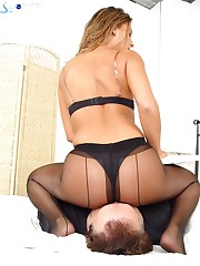 Chick in black nylon sat on slave