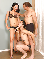 Babe straps on a dildo before threesome fuck