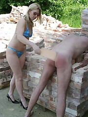 The mistress paddled a bad boy outdoor