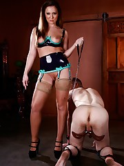 Dominatrix Maddy O'Reilly is going to take out her bad mood on her humbled submale's balls