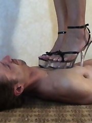 A thin stud submits to trampling by a explicit who is alternatively both barefoot added to shod, added to he also licks her feet