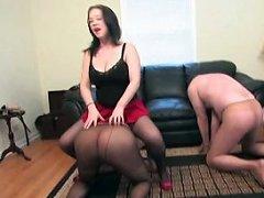 A dominatrix controls two dudes