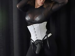 Strapon mistress wears corset