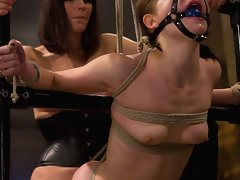 Hung and gagged lesbian sub get fucked hard with dildo