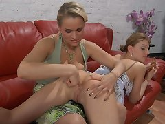 Lesbian gal gets spread and ass-fucked on the couch by a strap-on armed babe