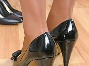 These black high heels really match her black stockings