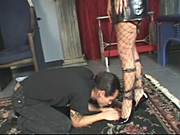 Michelle rushes her slave to her feet wearing fishnet thigh highs and strappy hardcore stilettos