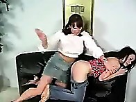 Melissa makes Marie bend over and then start hitting her plump ass cheeks