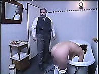 Beautiful blond fastened over a bench for a brutal caning