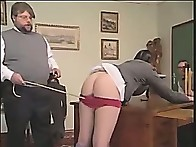 Young schoolgirl is tutored with the cane on her bared cheeks