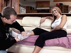 Busty Trina Michaels teasing her boyfriend with her assets which are her feet and her boobs