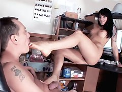 Victoria Sin sits in her office chair while her boyfriend stands in this hot barefoot fucking