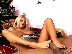 Sexy blonde Riley gives lucky guys hard cock a foot massage