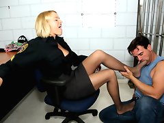 Hot sexy cop Krissy gives a lucky jail bird a nice footjob