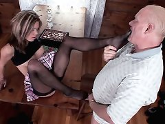 Blonde pornstar Natalie Sky wears a black stockings while getting foot licked by a mature stud