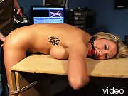 Bondage intern spanked and tied to office chair.