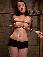 Asian slavegirl in predicament bondage.